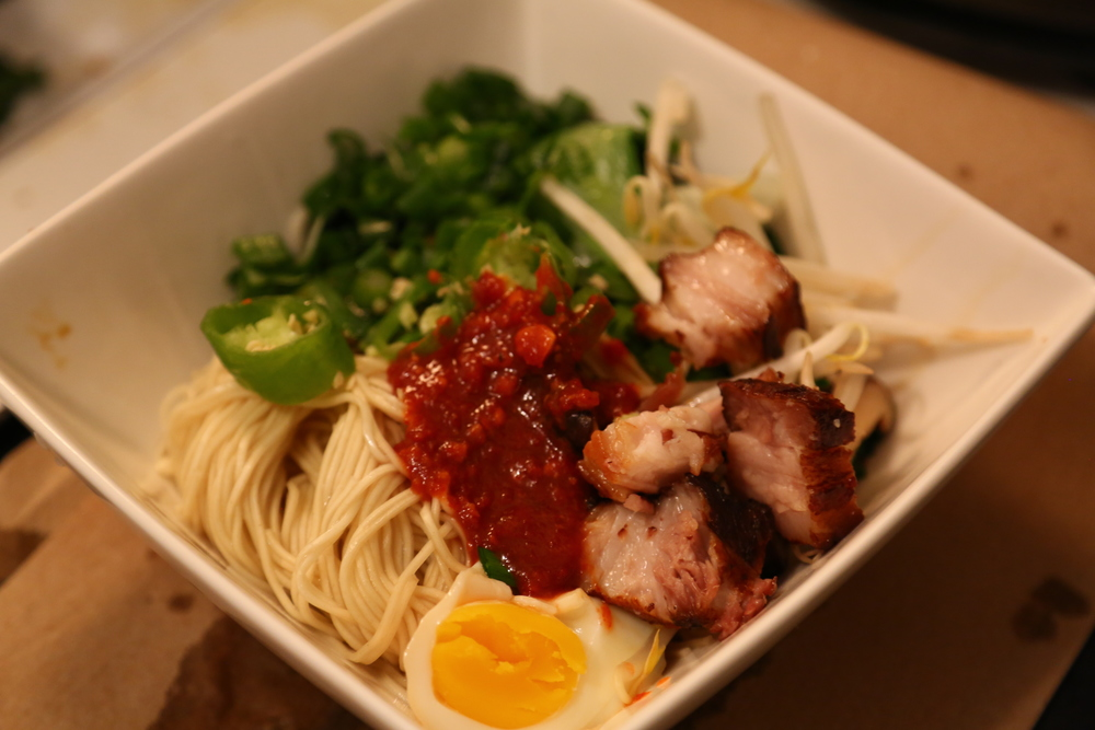 Fresh ramen noodles, pork belly marinated in sake, mirin and soy, sous-vided and then deep-fried, chives, extra-spicy Szechuan sauce (itself consisting of: fermented salted soybean, water, salt, wheat flour, chili, sugar, pickled vegetables, soy bean oil, garlic, salt, peanut, onion, sesame oil, yeast extract, maize starch), sous-vided egg marinated in juices from the pork belly, jalapenos, mayu (blackened garlic in sesame oil), bean sprouts, blanched bok choy and blanched Shanghai choy.