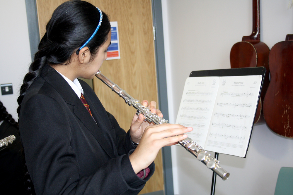 Music student playing the flute