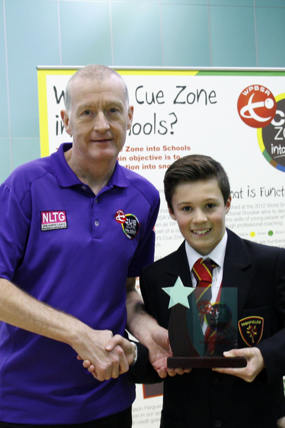 Challenge Winner, Jack Gibson, photographed receiving his award from Steve Davis. Jacks prize was a flat screen HD TV!