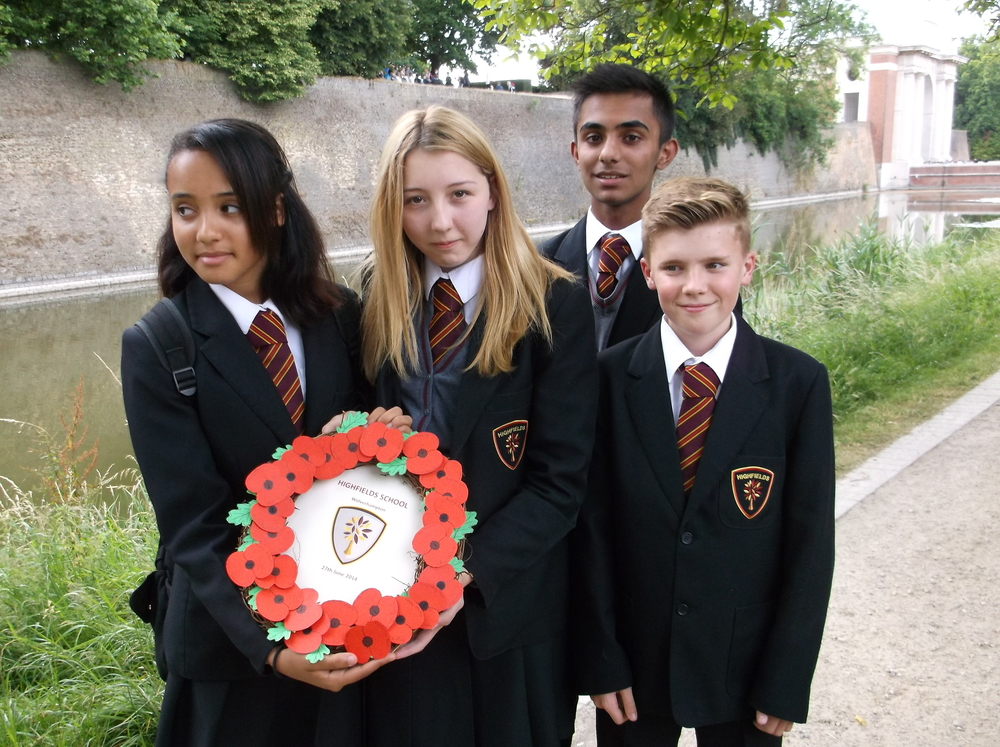 The school wreath was uniquely made of hand cut paper poppies, one for every student on the trip, with a card backing displaying the school emblem.