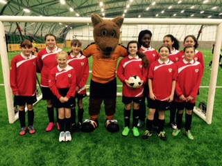 Yr 7&8 Squad with Wolfie.jpg