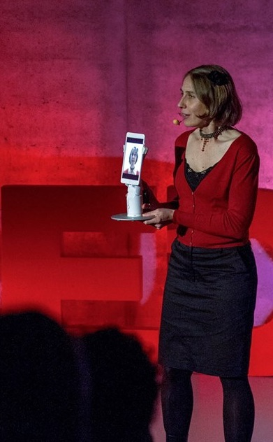Lisette on stage at TEDx