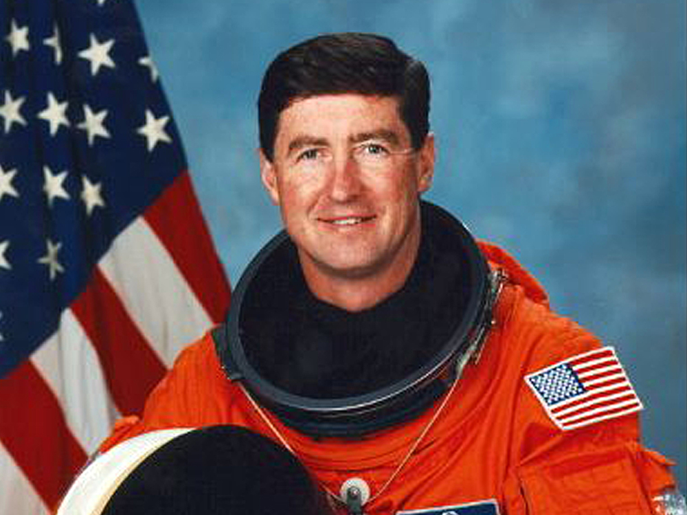 Tom Henricks,  STS-70 commander