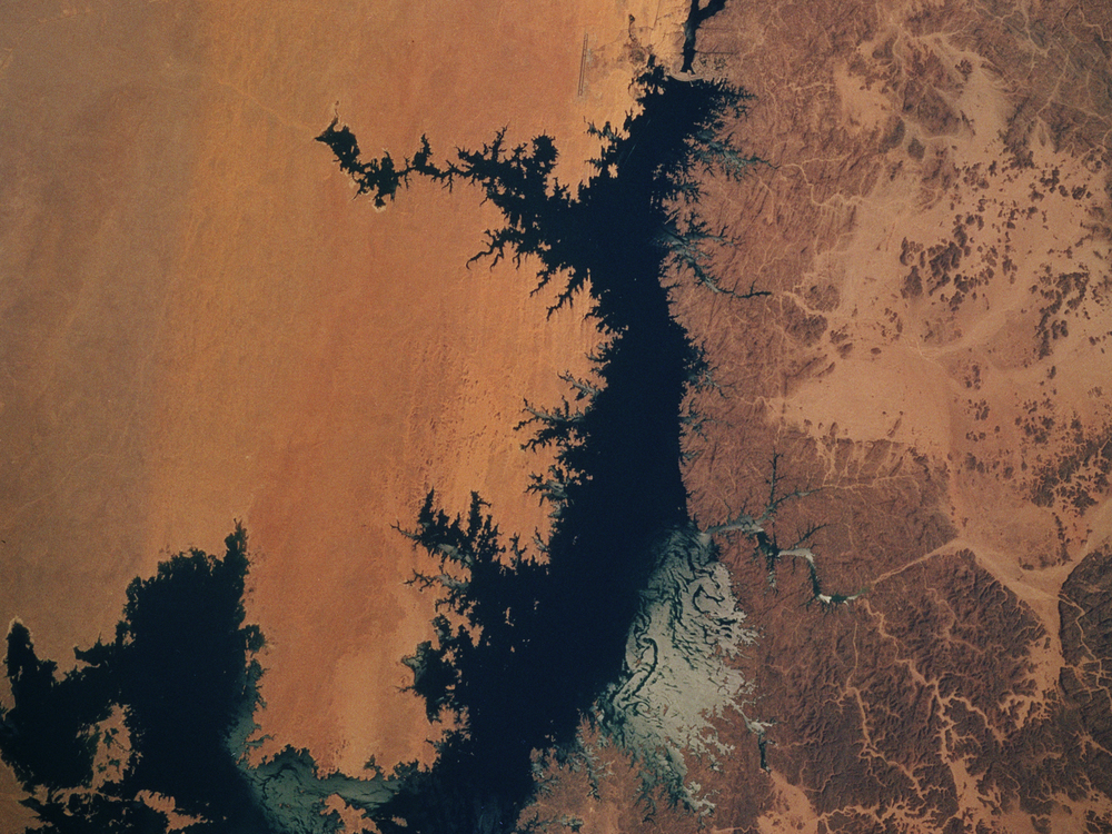 View of Lake Nasar with Aswan Dam and Nile River in southern Egypt.