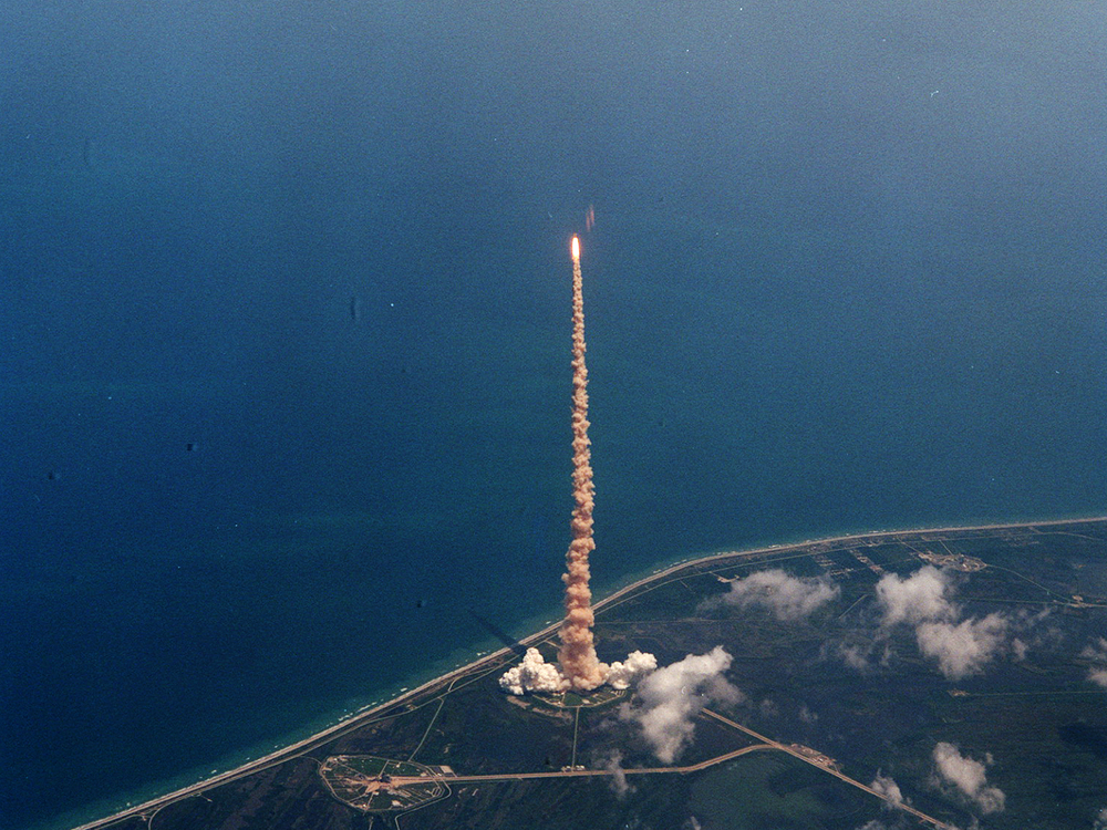 View of STS-94 launch taken from the Shuttle Training Aircraft flown by astronaut Ken Cockrell.