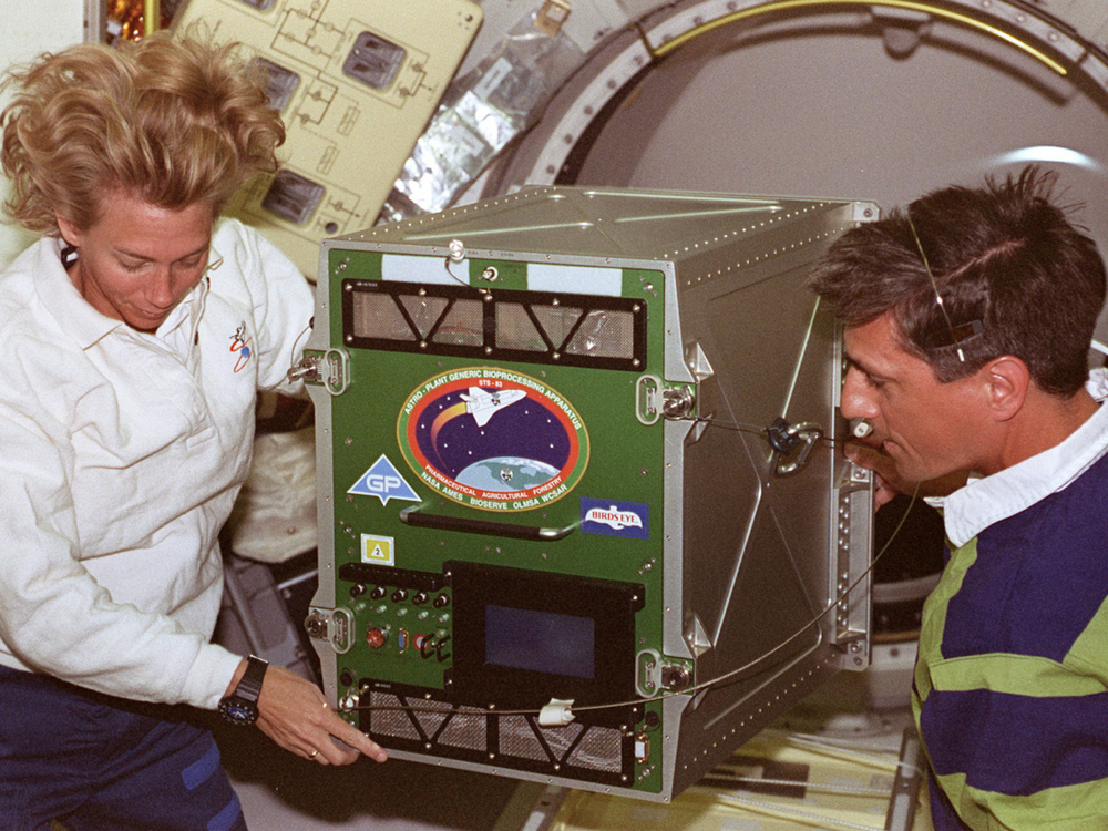 Susan (Still) Kilrain and I transferring experiment from middeck to Spacelab.