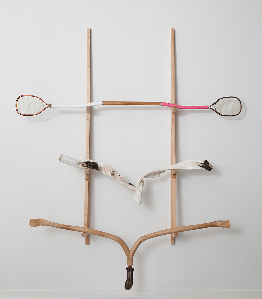 In Search of Water  (top to bottom):    Trying to Paddle Upcourt , 2013.   Racquetball racquets, cedar, grip tape;   Morphology of Flow  , 2013.   Vinyl downspout;   The Divining Tongue  , 2013.   Maple, cast bronze.