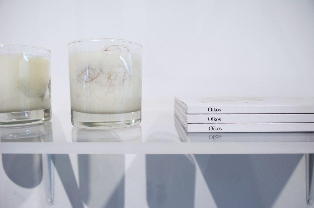 Ria Roberts  Design Within Reach , 2016 A shelving system composed of discarded plexiglass from exhibitions the Metropolitan Museum of Art, where Roberts works as a graphic designer.  Ria Roberts  Bougies , 2016 Soy candles with strands of human hair embedded in them.  Ria Roberts, editor  Oikos  1, 2015  The first issue of Oikos, a lifestyle magazine for realists, focusing on the pleasures and anxieties at the intersections of intimacy, domesticity and material culture.