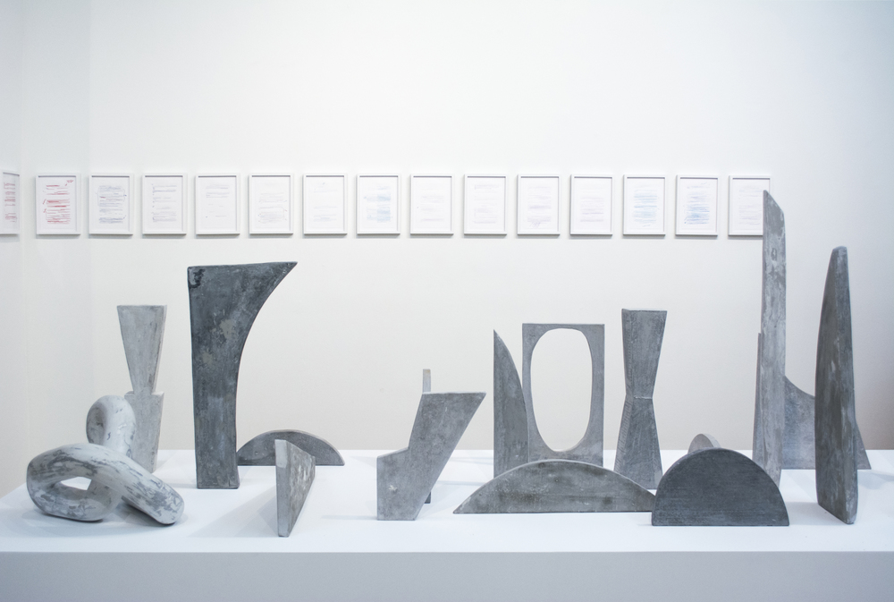 Background:   Becca Albee    RADICAL FEMINIST THERAPY (WORKING IN THE CONTEXT OF VIOLENCE, B.B. 1992)  series, 2016  Foreground:  Carolyn Salas   Line studies No.1-17, Movement studies No.5 , 2016  Cast hydrocal and graphite. Dimensions variable, on platform 120 x 42 x 24""