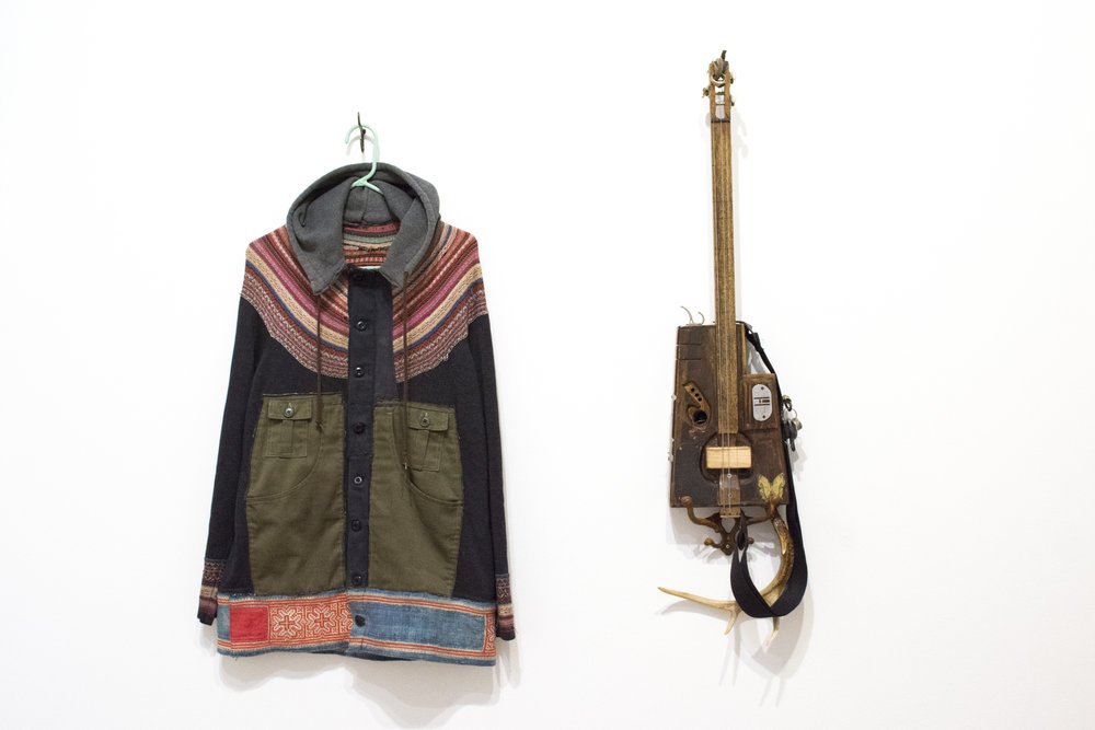 "Left: Jacket, 2017. 32""H x 24""W. Found Fabric.  Right: Thunder Zither, 1995-2017. 30.5""H x 10""W x 2""D. Mixed Media"