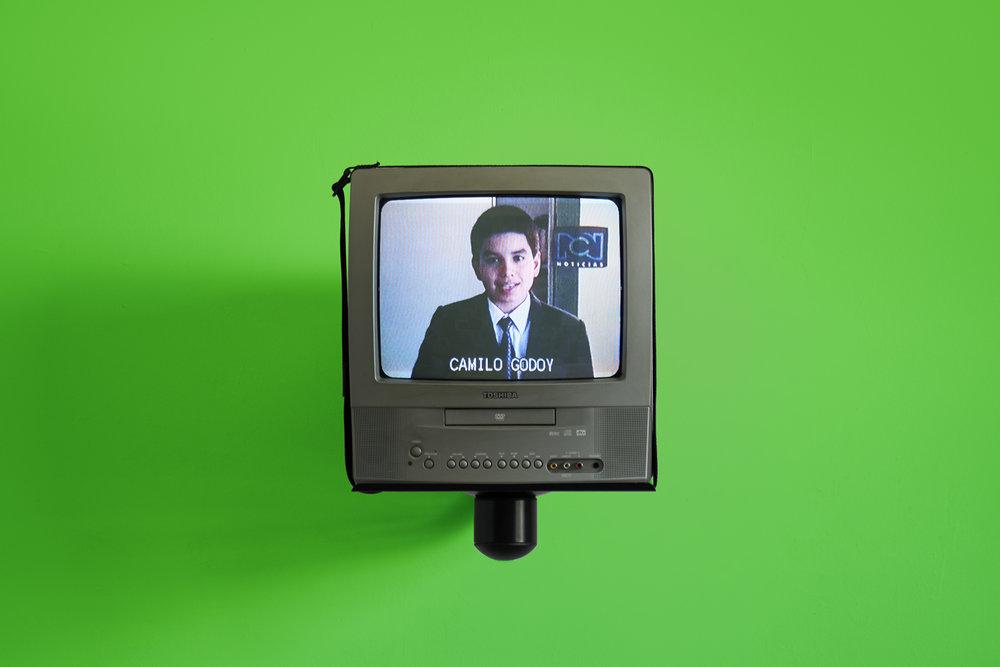 Camilo Godoy,  Noticiero  (installation view), 2002/2017. Video, sound, television set, wall mount, green screen wall, 10-minute loop.