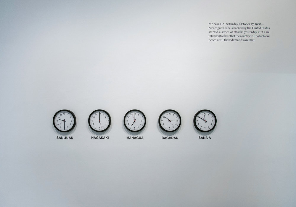 "WHO STOLE SAN JUAN? WHO DESTROYED NAGASAKI? WHO CRUSHED MANAGUA? WHO BOMBARDED BAGHDAD? WHO DRONED SANA'A?  2019  Mechanically altered 12"" diameter wall clocks, text on black vinyl Dimensions variable"