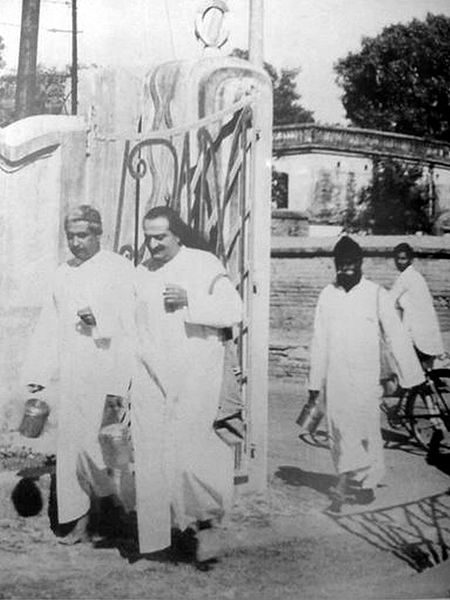 AVATAR MEHER BABA (center) walking with His close disciple and secretary, Adi K. Irani (left). This is the cover photo of the book, Tales of the New Life with Meher Baba, edited by Don E. Stevens.
