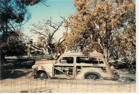 "THE BURNED OUT ""WOODY"" station wagon after the 1985 New Life Fire. Avatar Meher Baba rode in this car when He visited Meher Mount on August 2, 1956. (Sam Ervin photo, 1985.)"