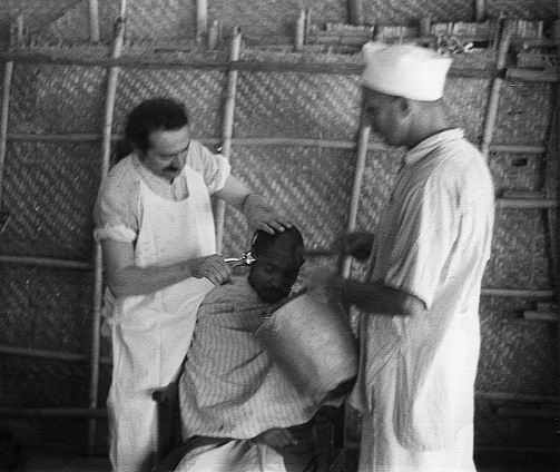 AVATAR MEHER BABA in India cutting a the hair of a mast - a God-intoxicated soul.