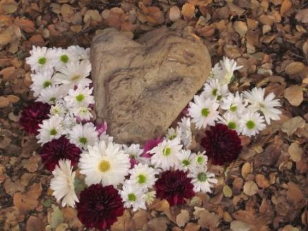 A HEART-SHAPED ROCK surrounded by flowers marks the spot where Avatar Meher Baba sat during his August 1956 visit to Meher Mount. (Wayne Myers photo, 2010.)
