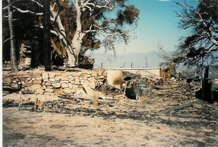 THE REMAINS OF THE FARMHOUSE and workshop after the October 14, 1985 New Life Fire. This is the site of the new Workshop completed in 2012. (Sam Ervin photo, October 1985.)