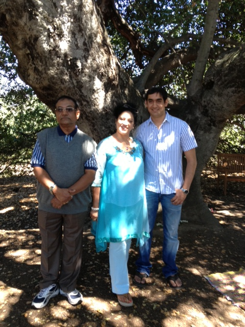 MEHERNATH KALCHURI and his wife Raj and son Zubin under Baba's Tree on June 6, 2013. Mehernath grew up in what is now the Avatar Meher Baba Perpetual Public Charitable Trust compound in Ahmednagar, India, under Meher Baba's guidance.