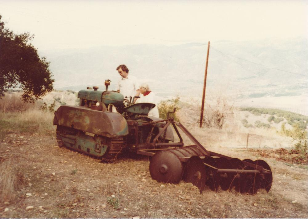 THE TRACTOR AGNES USED during the well adventure. Agnes Baron is discussing the working condition of the tractor in 1978 with a visitor. (Sam Ervin photo, 1978.)