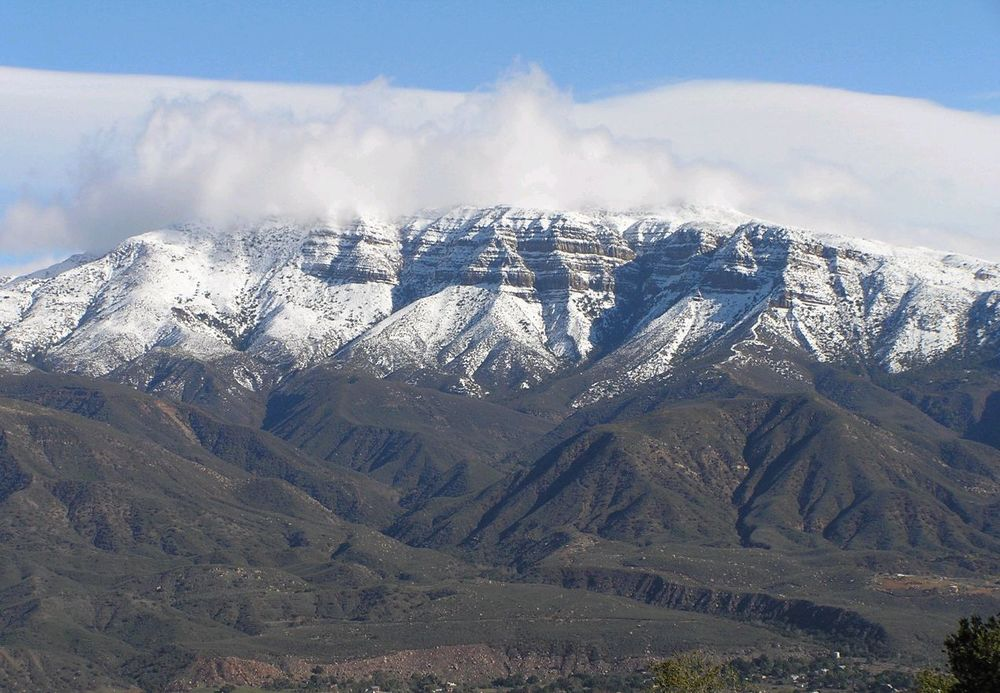 THE SNOW-CAPPED Topa Topa Bluffs in the Ojai Valley as seen from Meher Mount.