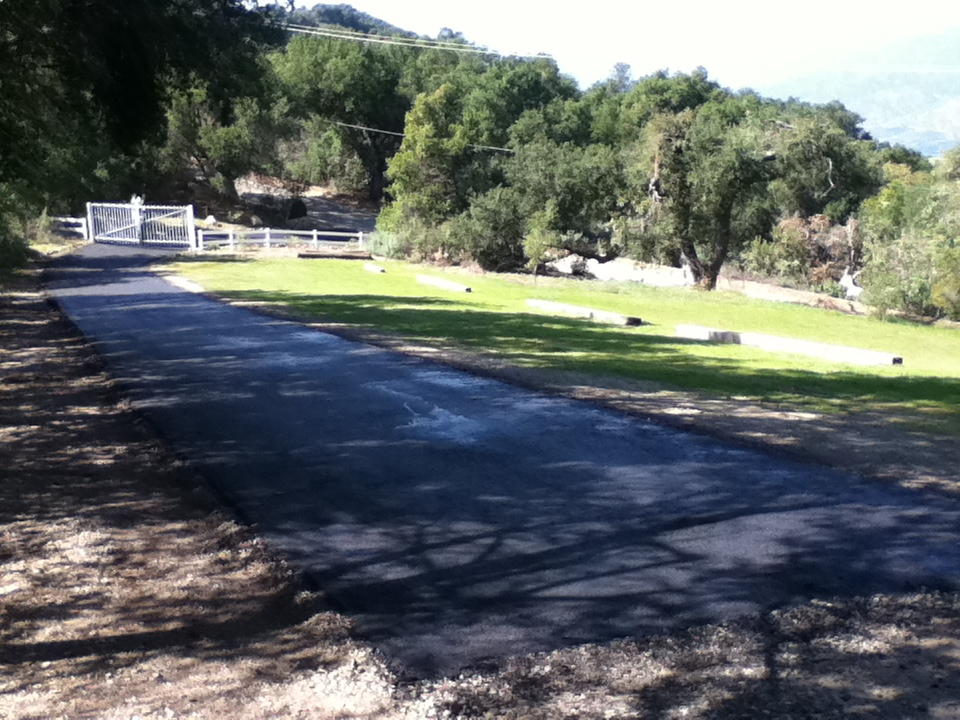 THE COMPLETED DRIVEWAY with new asphalt. (Leslie Bridger photo, March 2013.)
