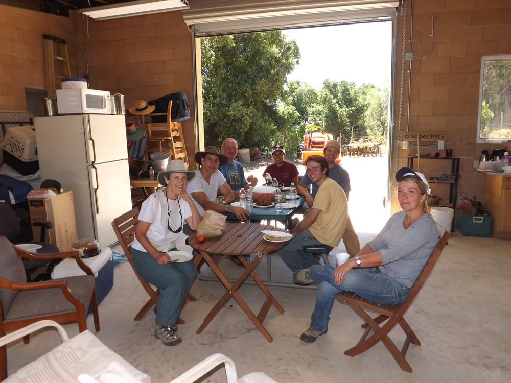 TAKING A LUNCH BREAK in the Workshop out of the July sun after working all morning on removing Yellow Starthistle. (Left to right): Margaret Magnus, Dusttin Paren, Sam Ervin, Michelle Choug, Josh McGill, Ian Dibble, and Samantha Bridger. (Photo: Leslie Bridger, 2012)