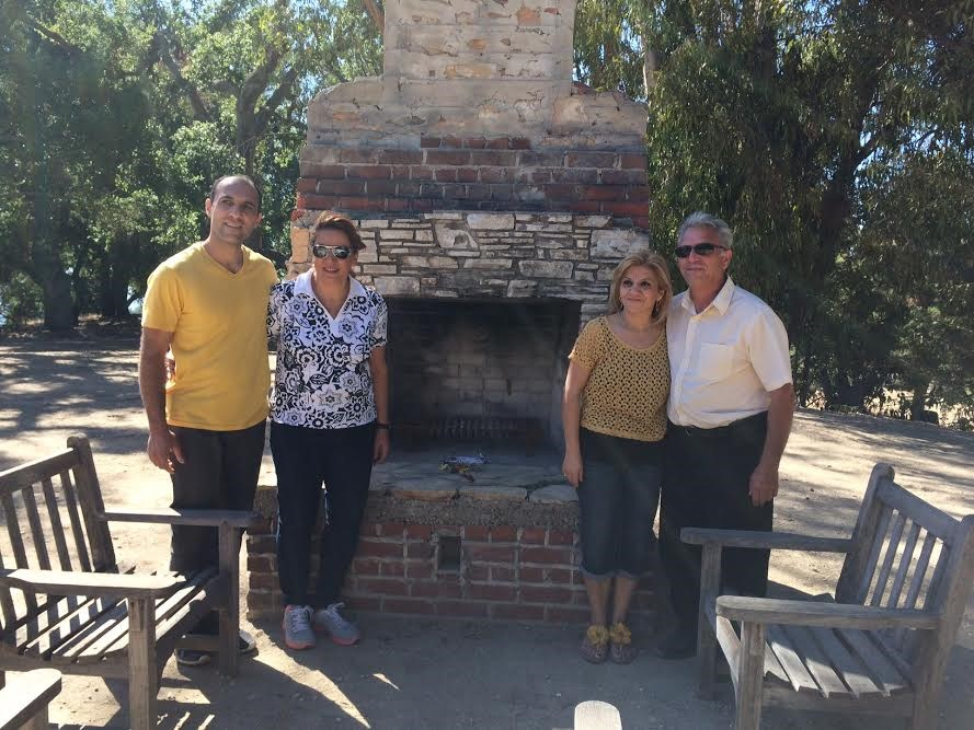 Afek Arezeemanian, Valed Maeilian, Anita Yerayan and Armon Toumasian stand by Meher Baba's chimney at Meher Mount. (Photo: Buzz Glasky, October 2014)