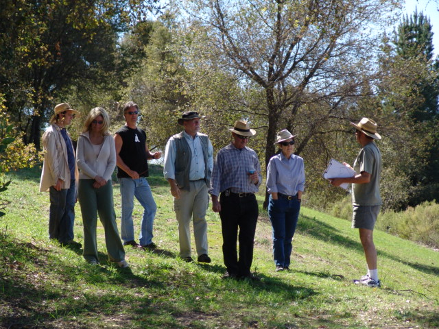 WALKING THE PROPERTY are (left to right): Glenn Russ; Elizabeth Arnold (Manager/Caretaker); Ray Johnston (Manager/Caretaker); Byron Pinckert (Volunteer Consulting Architect); Sam Ervin (Board President); Margaret Magnus (Board Secretary); and Jamshid Ebrahimzadeh (Board Member). (Photo: Nancy Pinckert, 2007)