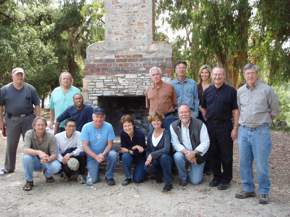 PARTICIPANTS IN THE PLANNING PROCESS are gathered around the chimney after a meeting. (Back row left to right) Marko Swearingen; Ken Pellman; Ron Holsey (Board Member); Michael Markley (Volunteer Legal Adviser); Ray Johnston (Manager/Caretaker); Elizabeth Arnold (Manager/Caretaker); Sam Ervin (Board President); Bing Heckman (Board Member). (Front row left to right) David McNeely; Kanji Miyao; Jim Whitson (Board Member); Margaret Magnus (Board Secretary); Nancy Pinckert (Volunteer Graphic Designer); and Byron Pinckert (Volunteer Consulting Architect).