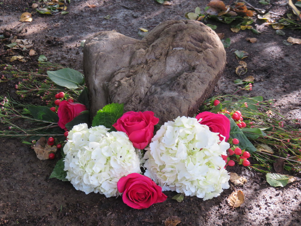 A HEART STONE and flowers mark the spot under Baba's Tree at Meher Mount where Avatar Meher Baba sat during His visit on August 2, 1956. (Photo: Wayne Myers,  Amartithi  2016)