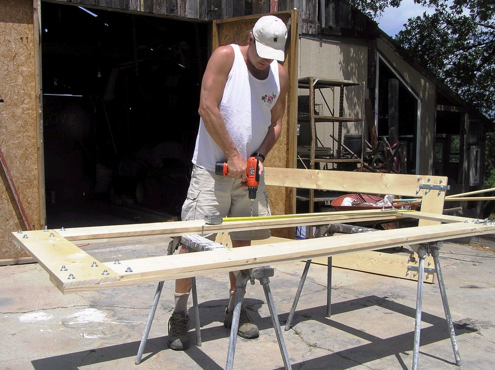 RAY JOHNSTON is building a gate in the mid-2000s to manage Meher Mount access. The new Workshop has not yet been built. (Photo: Elizabeth Arnold)