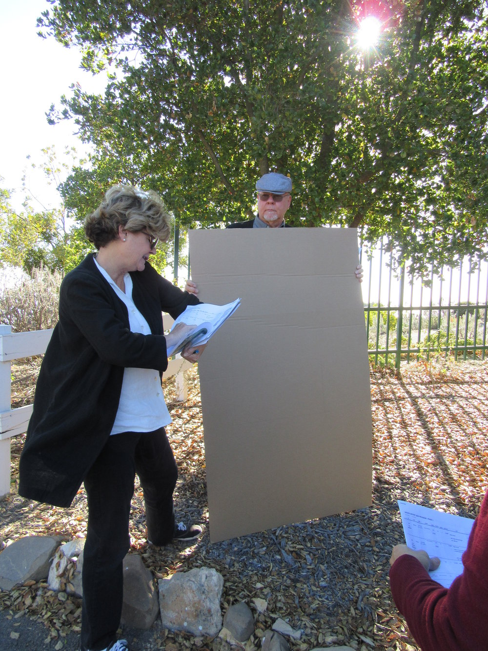 NANCY & BRYON PINCKERT and the Stone Sign & Marker Committee determine placement and final sizes of the stones using cardboard cutouts before the signs go into production. (Photo: Margaret Magnus, November 2016)