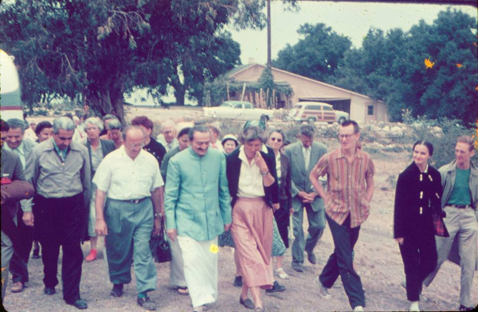 AVATAR MEHER BABA (center, blue coat) with His followers at Meher Mount on August 2, 1956. (Photo: Meher Archive Collection)