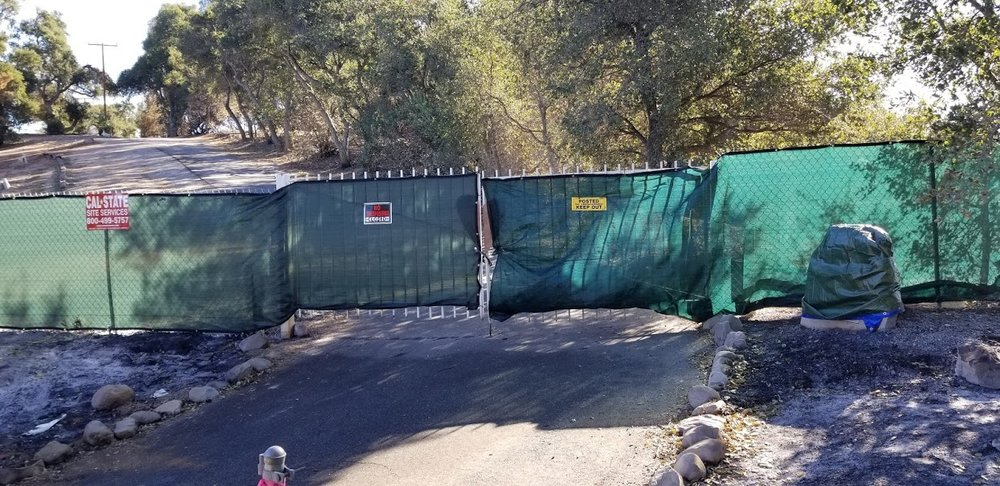 A TEMPORARY SECURITY FENCE at Meher Mount. Due to safety concerns and lack of water, Meher Mount remains closed to visitors. It will be open  only  for work volunteers on Sunday, January 28, 2018. All others will be asked to leave. (Photo: Margaret Magnus, January 5, 2018)