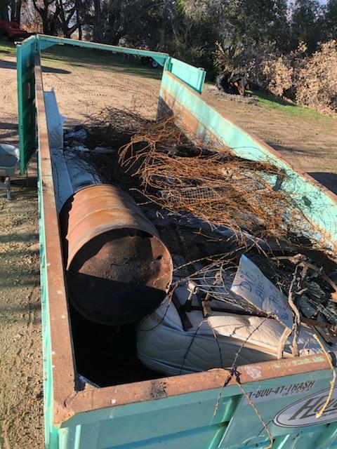 A DUMPSTER FULL OF DEBRIS from the January 2018 Fire Cleanup Day. (Photo: Bing Heckman)