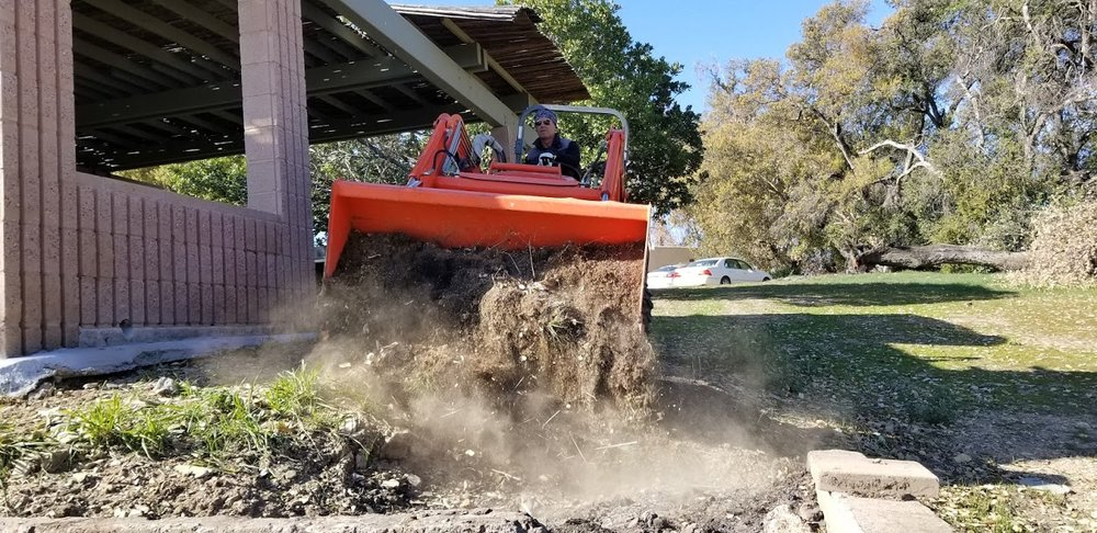 RAY JOHNSTON moving dirt from elsewhere on the property to fill in the semi-hazardous hole near the Topa Topa Patio. (Photo: Margaret Magnus, February 21, 2018)
