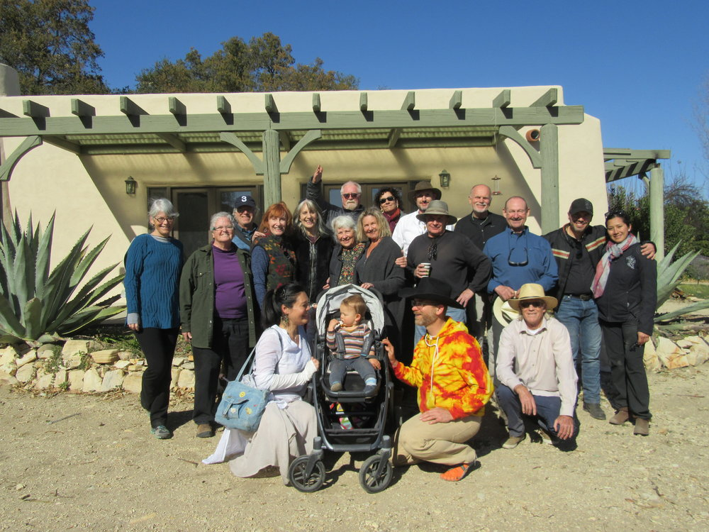 A GROUP PHOTO after  arti  on Baba's Birthday at Meher Mount. (Left to right, standing) Kristina Somma, Cassandra Bramucci, Robert Turnage, Erin Sommerville, Candy Bloeme, Buzz Glasky, Ginger Glasky, Maureen Lehman, Marta Flores, Nigel Sampson, Jim Whitson, James Whedon, Sam Ervin, Fernando Escobar, Rachael. (Left to right, kneeling) Mai Abe, Solomon and Mark Bonnlander, Tim Hurley. (Photo: Margaret Magnus, February 25, 2018)