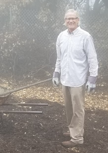 TIM HURLEY spreading the mulch under Baba's Tree at Meher Mount. (Photo: Margaret Magnus, March 10, 2018)