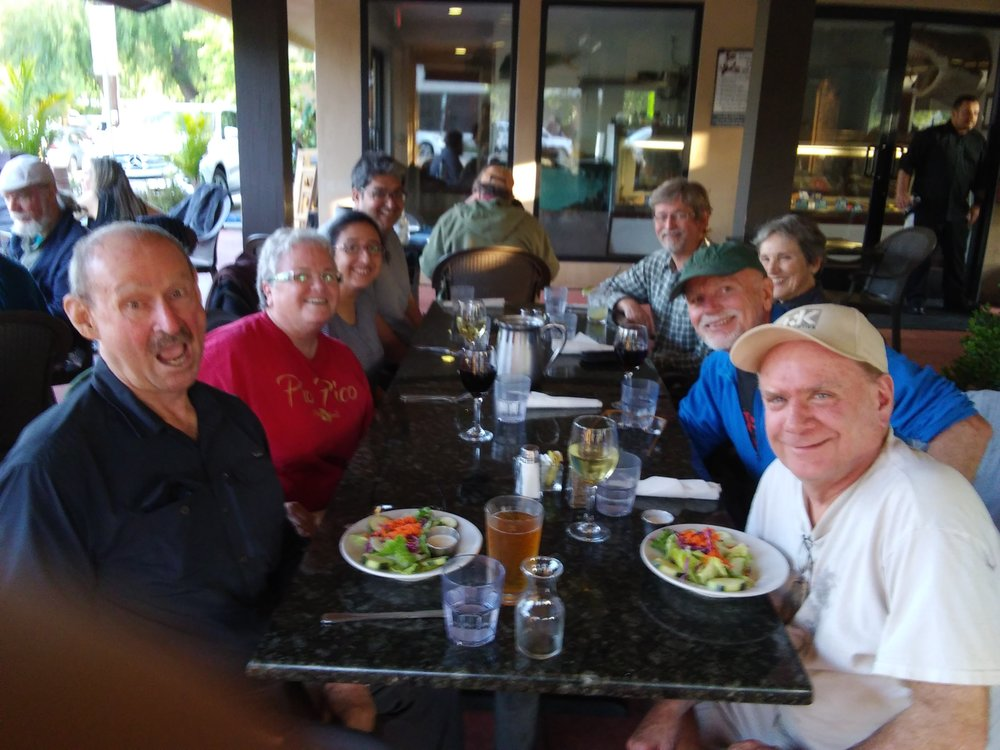 RELAXING AFTER A HARD DAY'S WORK at Sea Fresh Restaurant in Ojai. (Left to right) Sam Ervin, Cassandra Bramucci, Khushnam Crawford, Homayar Gandhi, Eric Turk, Margaret Magnus, Jim Whedon and Jim Whitson.