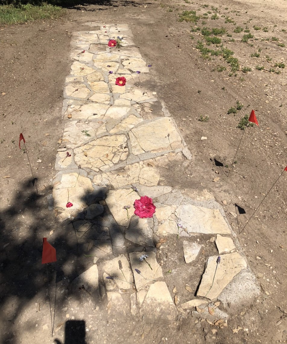 FLOWERS on part of Baba's Walkway were placed by grandchildren of Kyle and Lisa Morrison, who were in residence in May 2018 helping to take care of Meher Mount. This walkway is near the circular driveway by the Visitor Center/Caretaker Quarters. Avatar Meher Baba used the walkway to reach the guesthouse where He spent time with His followers on August 2, 1956. (Photo: Cassandra Bramucci, May 2018)