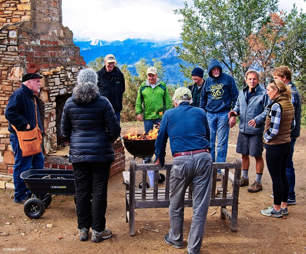 AROUND THE DHUNI at Meher Mount. (Left to right) David Trombley, Agnes Montano, Robert Turnage, Kristen Tarpey, Mike Tarpey, Kyle Morrison, Jim Whedon, David Springhorn, Jim Whitson and Fred Stankus. (Photo: Juan Mendez, January 12, 2019)