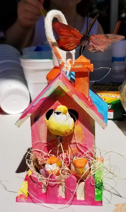 A BIRD HOUSE painted and decorated by one of the younger birders visiting Meher Mount for Family Bird Watching Day, April 6, 2019. Volunteer Lisa Morrison organized the bird art table for the kids. (Photo: Margaret Magnus)