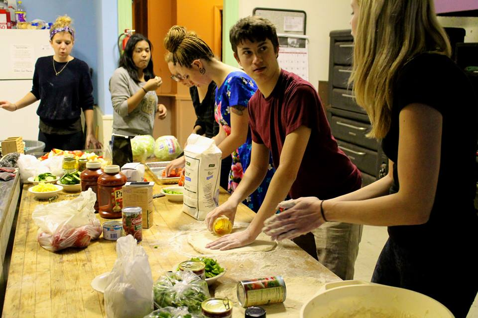 Semester in Detroit students bonding during their Immersion Weekend while cooking pizza FROM SCRATCH for more than 30 people!
