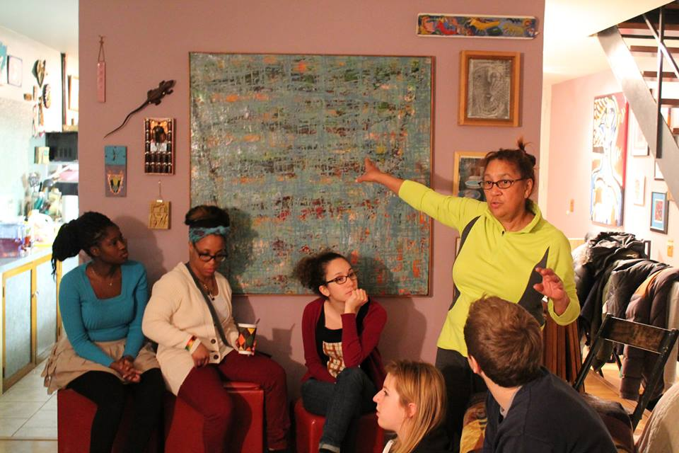 SiD students at Lotlita Hernandez's home learning about the art in their teacher's home while eating dinner.