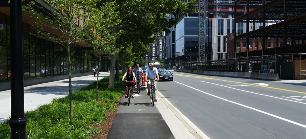 Above: New section of Binney Street opened in 2015 between 1st and 3rd Streets. This redesign project intends to continue the raised cycle track.