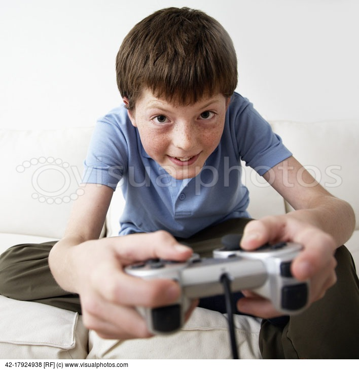 portrait-of-pre-teen-boy-playing-video-game.jpg