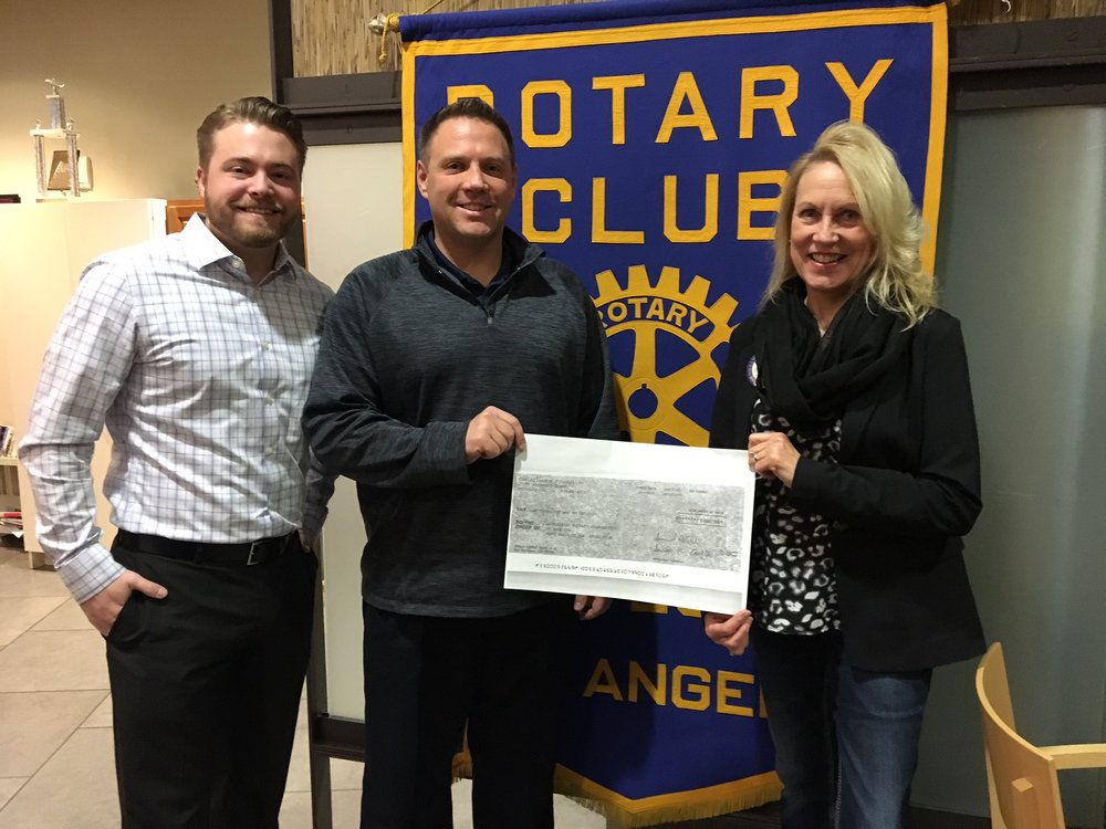 Left to Right:  Andy Callis, President of Nor'Wester Rotary, Matt Elwood, owner of Allstate Insurance and Helen Arnold, Nor'Wester Rotarian.