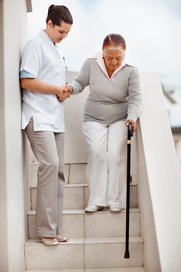 bigstock_nurse_helping_a_senior_woman_d_60677772.jpg