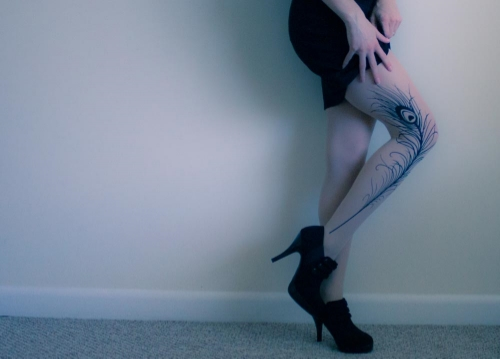"""Side view of peacock feather tattoo tights in """"light mocha"""" from Etsy shop """"Tattoo Socks"""""""