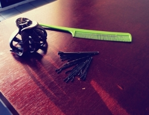 Random items that may come in handy for your hair: Large clip, bobbi pins, and a comb/brush